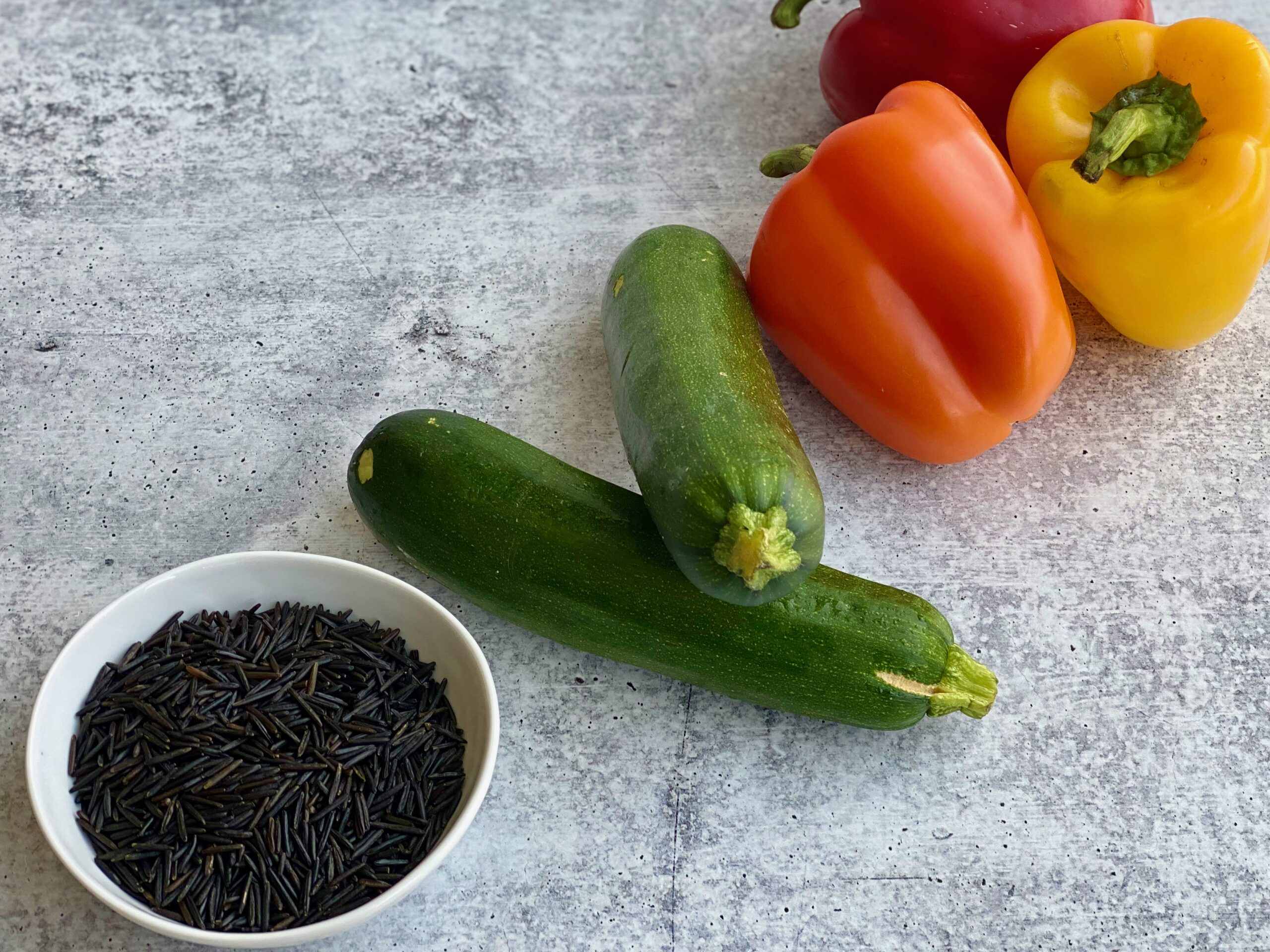 An image of rice, zucchini and bell peppers