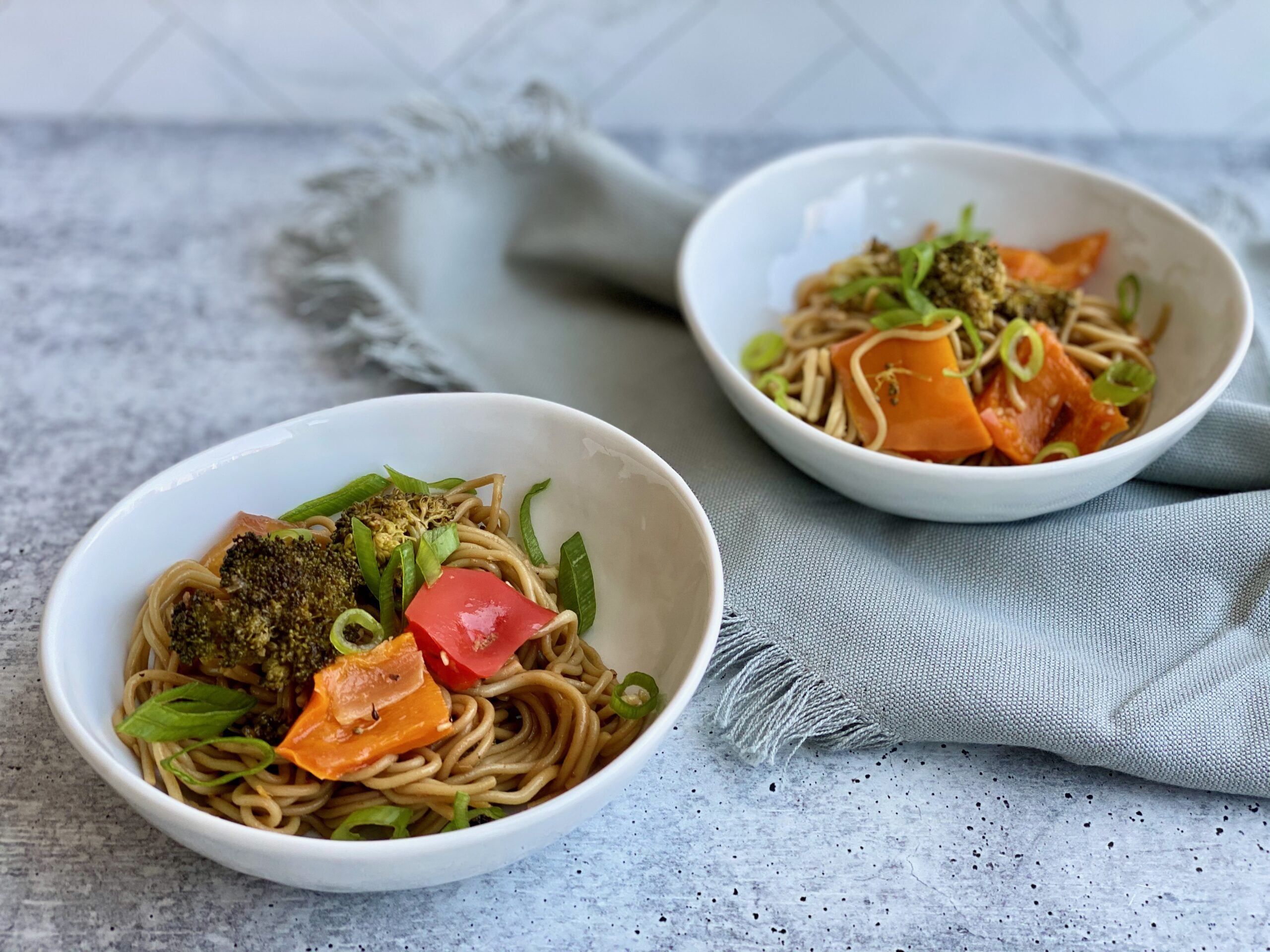 Image of two bowls with ramen noodles and veggies